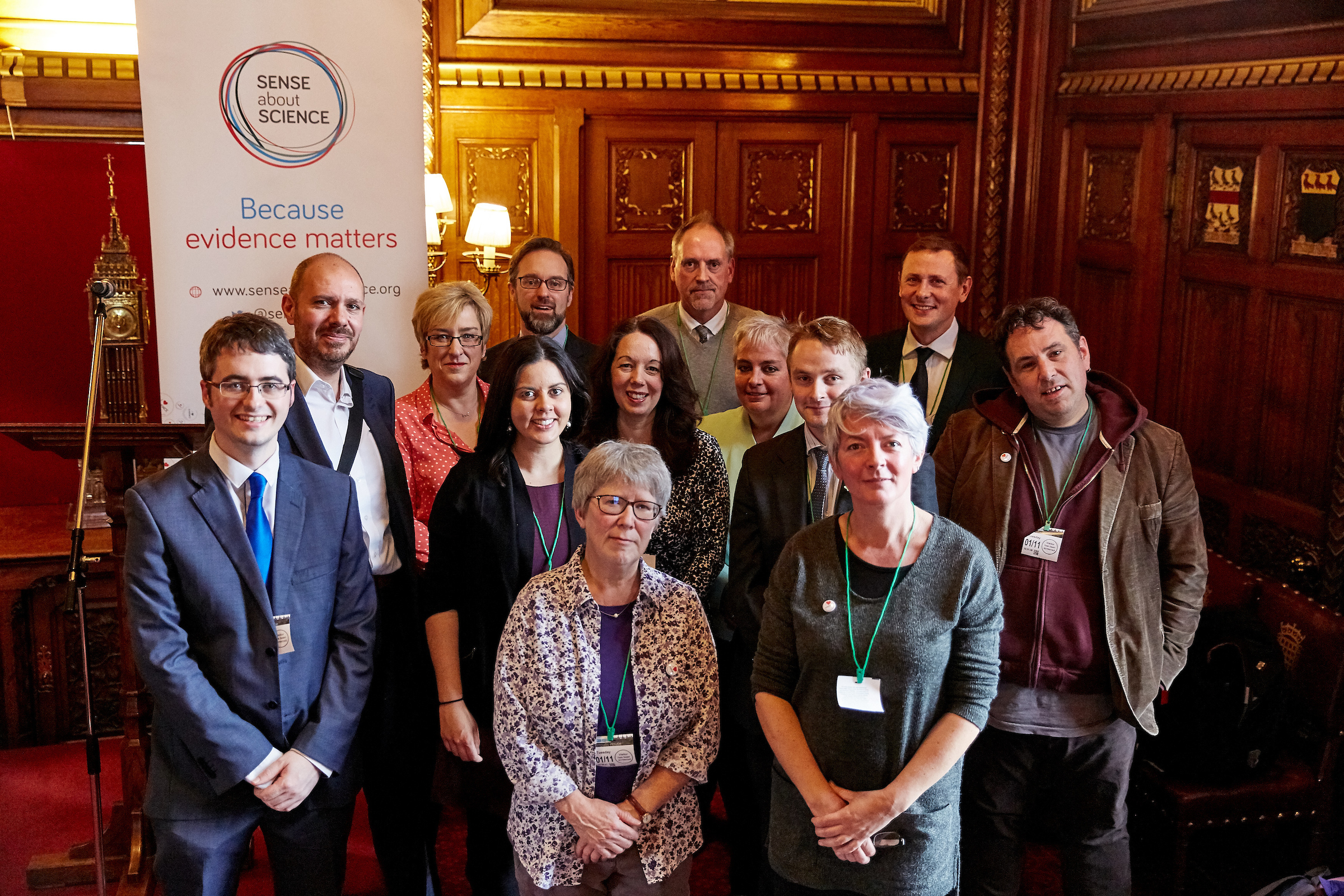 Speakers from the evidence matters event in parliament standing in front of the Sense about Science banner.